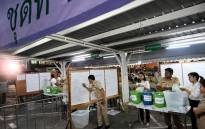 Electoral officials count votes at a polling station in Bangkok on 24 March 2019 after polls closed in Thailand's general election. Picture: AFP