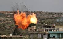 A picture taken on 5 March 2020 shows an explosion following Russian airstrikes on the village of al-Bara in the southern part of Syria's northwestern Idlib province. Picture: AFP