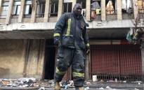 FILE: A Johannesburg firefighter on the scene of the fire in Nugget Street, Johannesburg. Picture: Hitekani Magwedze/EWN