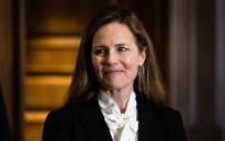 Judge Amy Coney Barrett, President Donald Trump's nominee for the US Supreme Court, looks on as she meets with Senators on Capitol Hill in Washington, DC, on 1 October 2020. Picture: AFP.