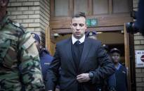 FILE: Oscar Pistorius leaves the High Court in Pretoria after the conclusion of sentencing arguments in his murder trial. Picture: Reinart Toerien/EWN.
