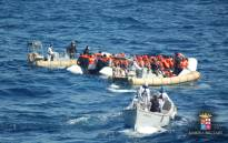 FILE: This handout picture released by the Italian Navy shows a rescue operation of migrants and refugees at sea, off the coast of Sicily, on 16 March 2016. Picture: Marina Militare/AFP.