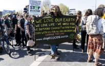 FILE: Climate change activists continue to block the road on Waterloo Bridge in London on April 20, 2019, on the sixth day of an environmental protest by the Extinction Rebellion group. Picture: AFP.