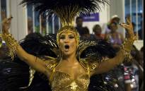 Brazilian singer Claudia Leitte performs in Mocidade de Padre Miguel samba school during the first night of the carnival parade at Sambadrome in Rio de Janeiro, Brazil on 8 February 2016. AFP /Vanderlei Almeida.