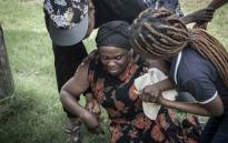 Antionette Mpianzi becomes emotional as she nears the river where her son Enock Mpianzi drowned during a visit to the Nyati Bush and River Break resort on 21 January 2020. Picture: Abigail Javier/EWN