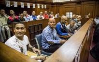 An alleged leader of the 28s gang, George Thomas and his 17 co-accused in court on 4 May 2015, they collectively face 141 charges ranging from murder to attempted murder. Picture: Thomas Holder/EWN.