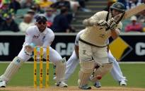Australia's batsman Chris Rogers (C) plays a shot during the first day of the second Ashes Test cricket match in Adelaide on December 5, 2013. Source: AFP.
