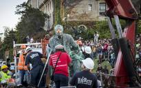 FILE: The controversial statue of Cecil John Roads sits on the back of a truck before being driven off the University of Cape Town campus on 9 April 2015. Picture: Aletta Gardner/EWN.