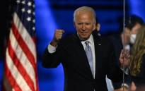 US President-elect Joe Biden holds up his fist after delivering remarks in Wilmington, Delaware, on 7 November 2020, after being declared the winners of the presidential election. Picture: AFP