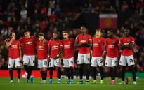 Manchester United player wait in the centre circle as penalties are taken after the game finishes 1-1 during the English League Cup third round football match between Manchester United and Rochdale at Old Trafford in Manchester, north-west England on 25 September 2019. Picture: AFP