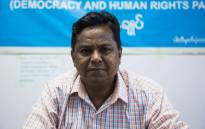 FILE: Rohingya candidate Abdul Rasheed, a member of the Democracy and Human Rights Party, poses for a photo in the party's office in Yangon on 12 August 2020. Picture: AFP