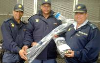 Police officials retrieved a stolen SAPS shotgun and ammunition. The weapon was stolen during land demonstrations in Zwelihle. Picture: @SAPoliceService/Twitter