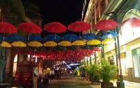 Umbrellas with the Mauritian flag colours at the Port Louis Waterfront in Mauritius. Picture: Refilwe Pitjeng/EWN.