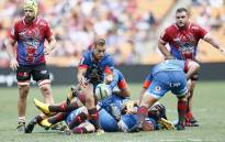 Bulls' Ivan van Zyl (C) passes the ball during the Vodacom Superhero Sunday rugby match between the Vodacom Bulls and the Emirates Lions at the FNB Stadium in Soweto on 19 January 2020. Picture: AFP