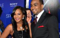 FILE: The late Whitney Houston's daughter Bobbi Kristina (L) and date arrive for the world premiere of the film 'Sparkle' at Grauman's Chinese Theater in Hollywood,California on 16 August, 2012. The film opens across the US on 17 August. Picture: AFP