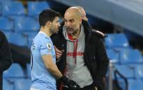 Manchester City manager Pep Guardiola (R) briefs striker Sergio Aguero during the English Premier League football match between Manchester City and Southampton at the Etihad Stadium in Manchester, north west England on March 10, 2021. Picture: Clive Brunskill/AFP