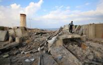 A Palestinian man walks on debris following an Israeli air strike around the southern Gaza Strip city of Rafah on 17 October 2018. Picture: AFP
