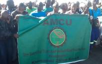 FILE: Amcu members march during one year anniversary at Lonmin's Marikana mine where 34 striking platinum workers were shot dead by police on 16 August 2012. Picture: Gia Nocolaides/EWN.