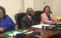 KZN Premier Willies Mchunu (C) at a media briefing after officially tabling the Moerane Commission report in the KZN legislature. Picture: Ziyanda Ngcobo/EWN.