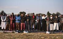 South African Muslims gather to offer Eid al-Adha prayers in an open field in Lenasia, Johannesburg, on 22 August 2018. Picture: AFP.