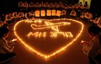 FILE: Hailiang International School lighting candles to pray for the passengers on the missing Malaysia Airlines flight MH370 in Zhuji, in Chinas Zhejiang province on 10 March 2014. Picture: AFP