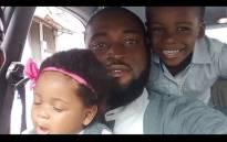 Joseph Blankson with his children. Picture: @jfkresoluteent/instagram