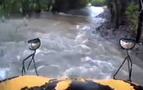 A school bus gets swept away in floodwaters after the driver fails to heed a warning sign!