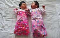 FILE: Newborn babies lie on a hospital bed in Beijing, China. Picture: AFP