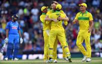 Australia's Jason Behrendorff (C) celebrates taking the wicket of India's Mahendra Singh Dhoni during the first one-day international (ODI) match between Australia and India at the Sydney Cricket Ground in Sydney on 12 January 2019. Picture: AFP
