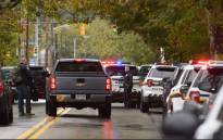 Police members respond to the site of a mass shooting at the Tree of Life Synagogue in the Squirrel Hill neighbourhood on 27 October 2018 in Pittsburgh, Pennsylvania. Picture: AFP.