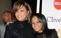 FILE: Singer Whitney Houston (L) and Bobbi Kristina Brown arrives at the 2011 Pre-GRAMMY Gala and Salute To Industry Icons Honoring David Geffen at Beverly Hilton on February 12, 2011 in Beverly Hills, California. Picture: AFP.