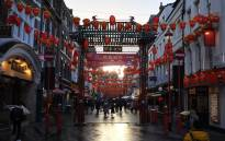 One of Chinatown's gates surrounded by decorative lanterns in London's Chinatown district. Picture: AFP