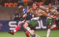 Photo on 11 October 1997 shows Français Ibrahim Ba (G) and Neil Tovey in the match during the World Cup prepations in 1998. Picture: AFP.