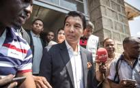 Madagascar presidential candidate Andry Rajoelina talks to media after casting his ballot in Antananarivo, on 7 November 2018. Picture: AFP