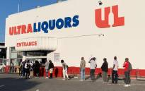 FILE: Customers queue outside the Ultra Liquors in Wynberg, Cape Town following the relaxation of alcohol sale restrictions on 1 June 2020. Picture: Kaylynn Palm/EWN