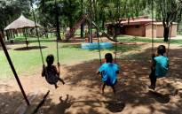 Children enjoying the swings on a playground. Picture: Werner Beukes/SAPA