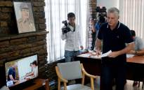 Cuban President Miguel Diaz-Canel prepares to cast his vote in the referendum for the new Cuban Constitution in Havana, on 24 February 2019. Picture: AFP