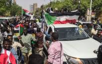 FILE: Sudanese protesters march towards the military headquarters during an anti-regime rally in the capital Khartoum on 11 April 2019. Picture: AFP.