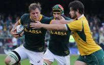 Duane Vermeulen tries to shrug off a tackle as Victor Matfield looks on during the Springboks' Rugby Championship match against Australia at Newlands on 27 September 2014. Picture: Aletta Gardner/EWN.