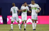 FILE: Algeria's forward Riyad Mahrez (C) celebrates with teammates Yacine Brahimi (R) Islam Slimani after scoring a goal. Picture: AFP