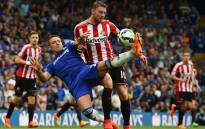 Sunderland's English striker Connor Wickham (R) vies with Chelsea's English defender John Terry during the English Premier League football match between Chelsea and Sunderland at Stamford Bridge in London on 24 May, 2015. Picture: AFP.