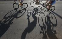 Some of the 30,000 cyclists ride in the annual 947 Cycle Challenge around the streets of Johannesburg on 16 November 2014. Picture: EPA.