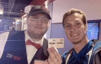 Agustin Alanis and a theatre attendant holding his 110th ticket stub for the 'Avengers: Endgame' movie. Picture: @agalanis17/Twitter.