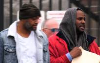 This still image from video shows singer R. Kelly (R) upon his release from Cook County jail in Chicago, Illinois, Saturday, 9 March 2019 after paying child support following a previous detention on sex abuse charges. Picture: AFP