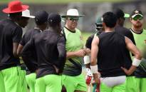 FILE: Former Zimbabwe cricket coach Heath Streak (C) chats with cricketers during a practice session at Galle International Cricket Stadium in Galle on 28 June 2017. Picture: AFP