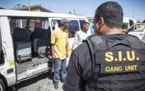 FILE: A member of Cape Town's Special Investigation Unit during a raid. Picture: Thomas Holder/EWN.