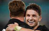 New Zealand's full back Beauden Barrett (R) congratulates New Zealand's fly-half Jordie Barrett after he scored a try during the Japan 2019 Rugby World Cup quarter-final match between New Zealand and Ireland at the Tokyo Stadium in Tokyo on 19 October 2019. Picture: AFP