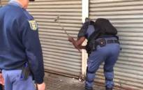 Police raid a shop in the Joburg CBD during an operation to seize counterfeit good on 7 August 2019. Picture: EWN