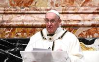 Pope Francis speaks during his sermon as he leads a Christmas Eve mass to mark the nativity of Jesus Christ on 24 December 2020, at St Peter's basilica in the Vatican. Picture: AFP