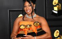 In this handout photo courtesy of The Recording Academy, Megan Thee Stallion, winner of the Best Rap Performance and Best Rap Song awards for 'Savage' and the Best New Artist award, poses in the media room during the 63rd Annual GRAMMY Awards at Los Angeles Convention Center on March 14, 2021 in Los Angeles, California. Picture: Kevin Mazur / The Recording Academy / AFP.
